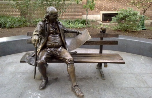 Bronze statue of Benjamin Franklin reading the Pennsylvania Gazette. Known as Ben on the Bench by University of Pennsylvania students.